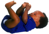 Photographs of a baby laying on his back with his arms and feet in the air.